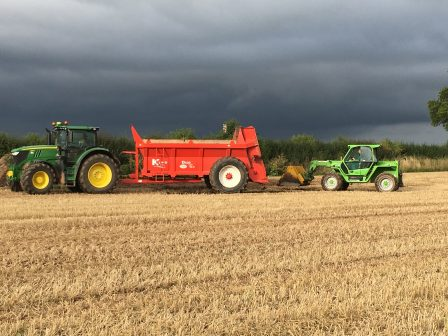Spreading chicken manure prior to planting stubble turnip and forage rape.